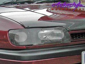 Toyota Yaris Sedan 06 Carbon Look Headlight Guard-0