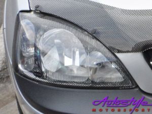 Opel Corsa 02+ Carbon Look Headlight Guard-0