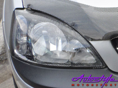 Opel Corsa 02+ Carbon Look Headlight Guard
