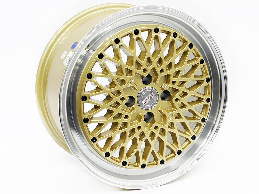 17″ L1497 4/100 Gold with Silver Lip Alloy Wheels
